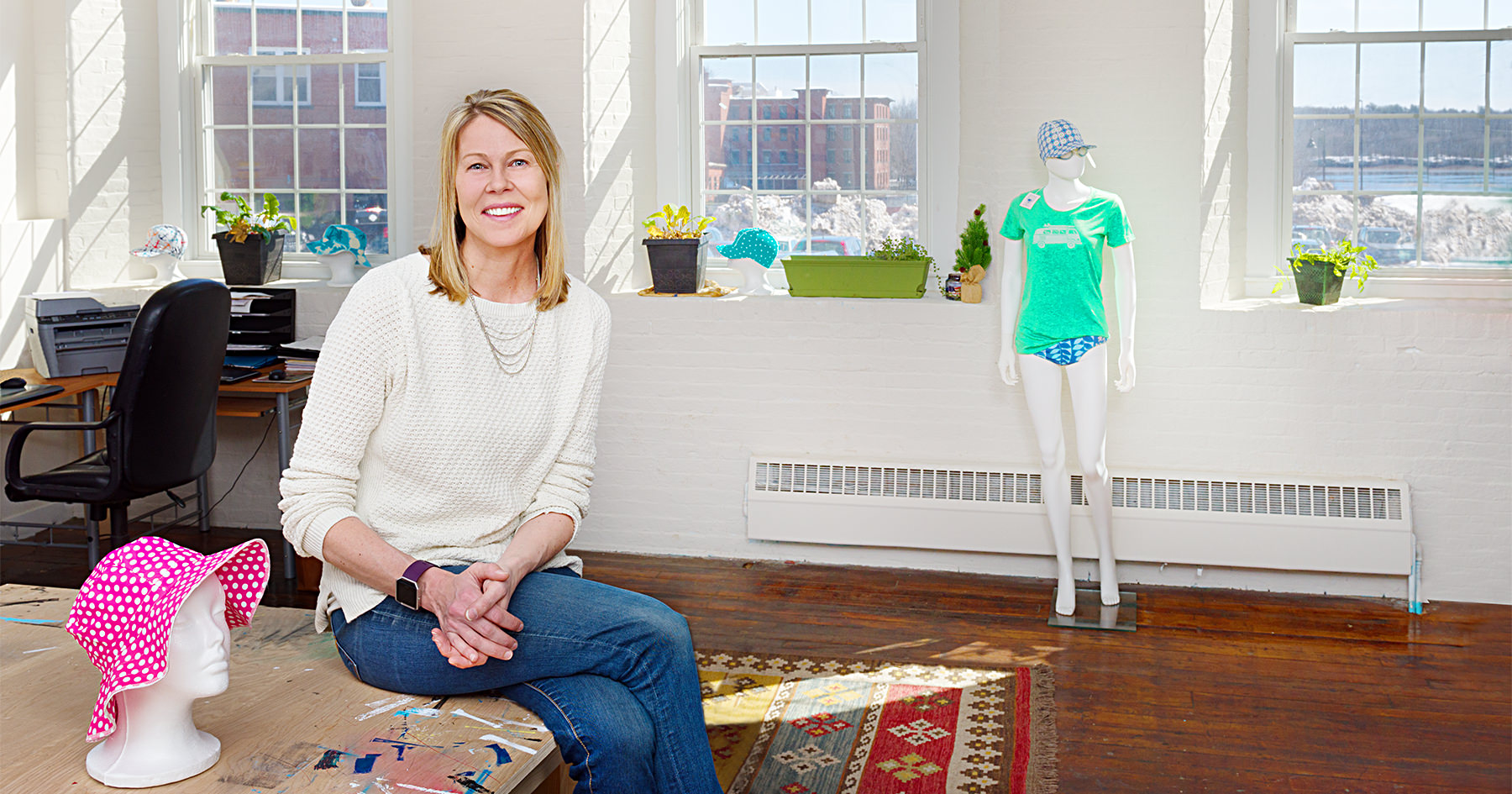 Karen Gellis, owner of Swimlids, stops for a brief moment in her studio at the Pepperell Mill Campus to be photographed by Portland Headshot.