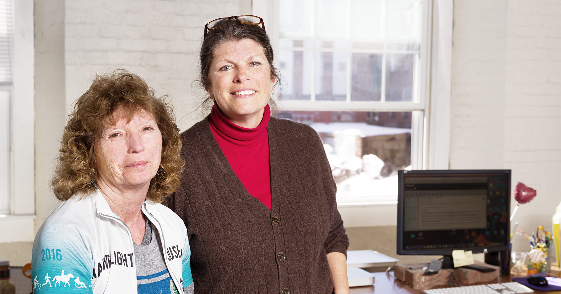 Carole and Nancy manage the Eastern Trail, part of the multi-state East Coast Greenway, from their offices at the Pepperell Mill Campus. Photograph by Portland Headshot