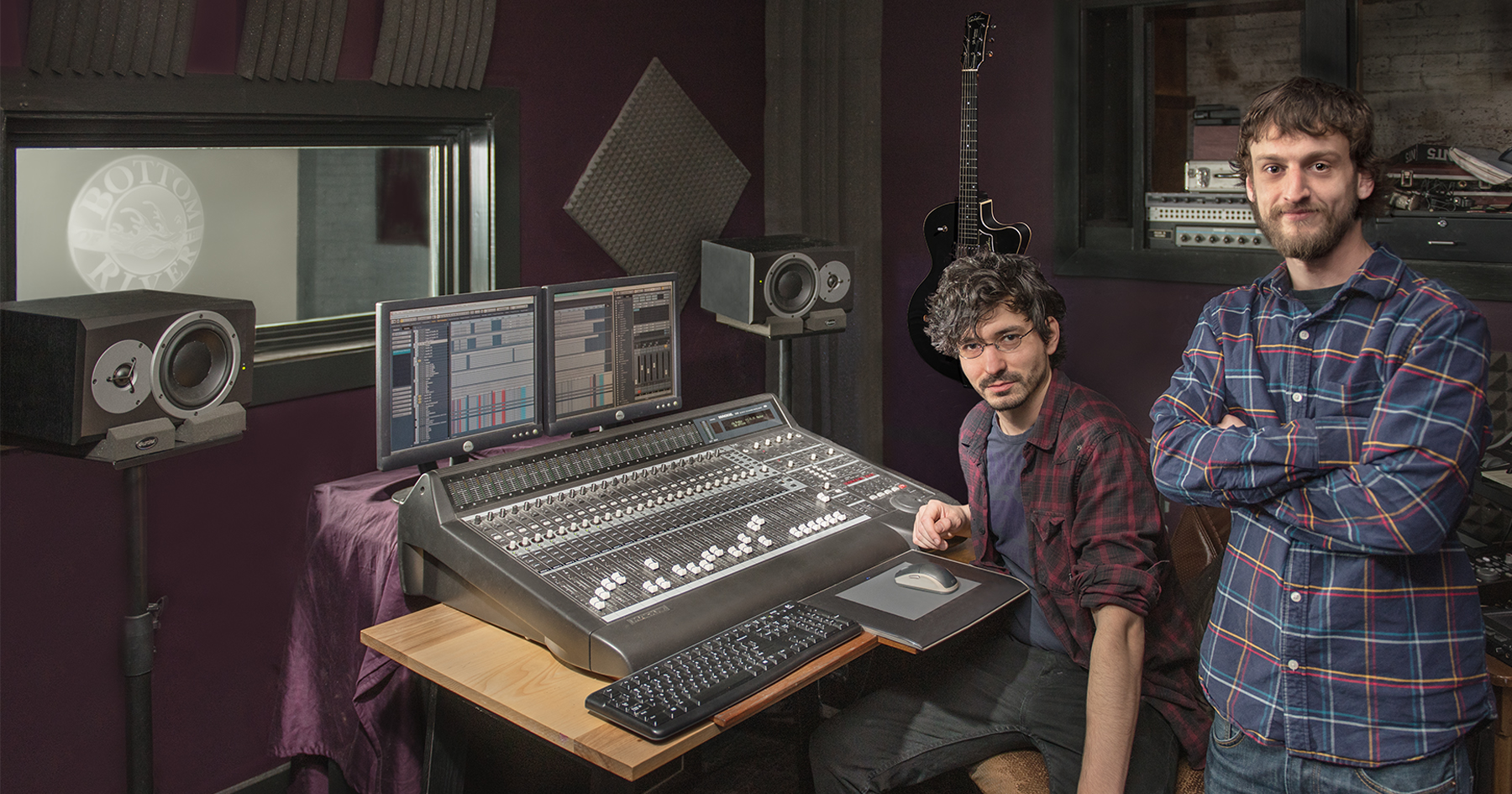 Nick Bilotta and Brian Andrews at the controls of their recording studio in the Pepperell Mill Campus. Photograph by Portland Headshot.